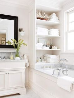 Gorgeous shelving in bathroom.