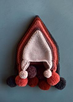 Tunisian Crochet Pointy Pom Pom Hat - free pattern in baby-adult sizes from Purl Soho/Purl Bee.