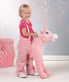 """Giddy Up Unicorn by LSI. $39.99. Your child simply steps into the Giddy-Up Unicorn's hind """"legs"""" and before you know it, they're """"riding!"""" These steads offer hours of creative fun for children.With the Unicorn, a little girl can become a make-believe fairy princess. Measures 28"""" from the nose to the beginning of the tail; the back leg section has an 18"""" circumference waist and is 25-1/2"""" long. Polyester. For ages 4 and up."""