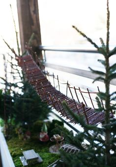 homemade swinging bridge in the fairy garden via seejaneblog