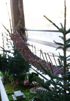 homemade swinging bridge in the fairy garden via seejaneblog