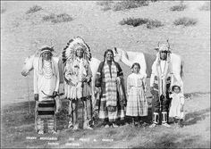 Heavy Runner, Flying Chief, and Topikkinii with their children (Blood/Kainai), 1911 by A. Rafton Canning.