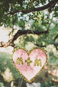wedding pinata - photo by Gina and Ryan Photography http://ruffledblog.com/bohemian-ojai-wedding-at-calliote-canyon
