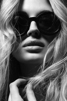 Voluptuous lips and huge black glasses