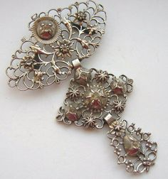 """Georgian or earlier stone set STOMACHER pin measuring 4 5/8"""" by 1 3/4"""". Set with what looks like Gadroon-rock crystal that has been mine cut"""