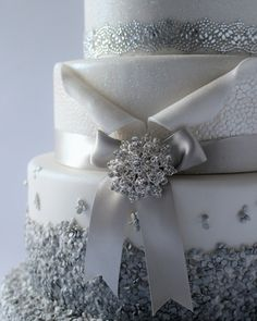 5 tier showstopper wedding cake. It's sparkle and shine from top to bottom with this wedding cake. From the glittery top tiers right down to the shimmering sequin clad bottom tiers it is just a celebration of fairy tale magic.