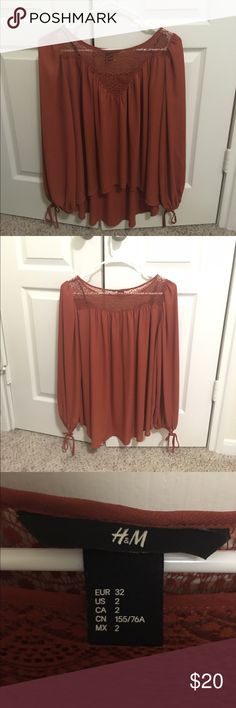 Burnt Orange Drapey Shirt This flowy blouse will look good for any summer or spring outing! Worn once! Good condition practically brand new! H&M Tops