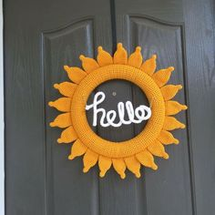 "Made this wreath thanks to a free pattern of Repeat, Crafter, Me. Then I crochet a tube and use wire to form the word ""hello""."