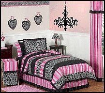 creates a stunning boutique setting for your little fashionista. This designer girl bedding set uses a sensational collection of JoJo exclusive 100% Cotton fabrics. It has a black and white scroll cotton print, a bold designer stripe and a coordinating mini black and white polka dot print. The gorgeous color palette of pink, black and white will set up your child's room in high style