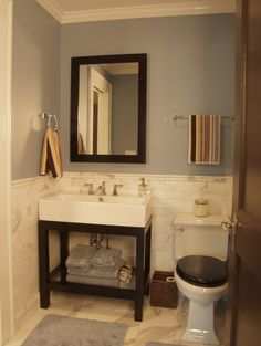 Black toilet seat with wood pedestal sink - - traditional bathroom by Red Level Renovations, LLC