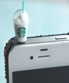 this phone plug features a miniature starbucks frappucino drink. it measures…