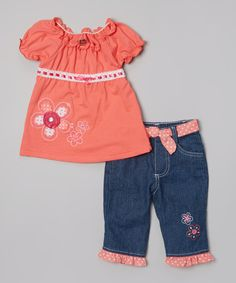 Convenience shouldn't be a luxury, and this comfy set comes perfectly paired for effortless styling. A darling flower appliqué on the top and ruffles on the jeans take this ensemble from sweet to sensational.