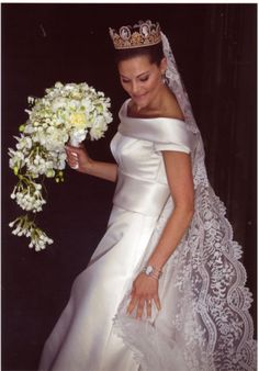 Crown Princess Victoria of Sweden in a wedding dress by Pär Engsheden.