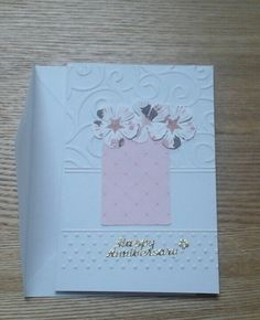 Embossed card. Punched out label. Die cut flowers.