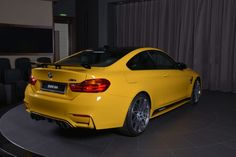 Speed Yellow stands when paired with the BMW M4 Coupe, as seen in these new photos by BMW Abu Dhabi Motors.