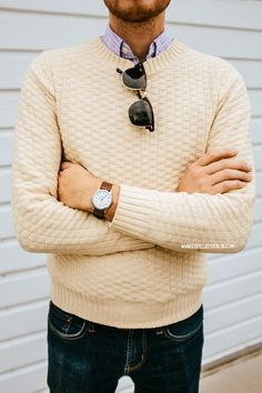 cream sweater and jeans
