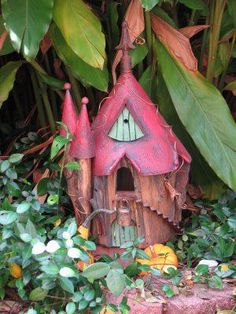 fairy house. OIL FUNNEL ROOF AND WOOD STUMP BOTTOM . HOW INTRESTING