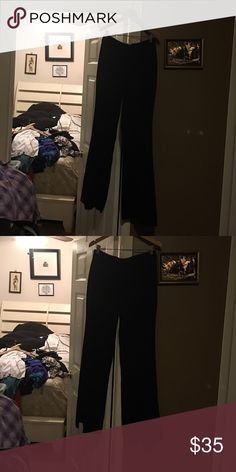 Women dress slack Button and zipper in front two small pocket on back hip and a split down each leg in back and belt joker if desire belt didn't come with a belt just design that way. Hardly worn only twice bebe Pants