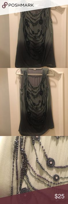 Green and black beaded sleeveless top Purchased in an upscale boutique in Miami. Green and black top with beaded embellishments. Tops