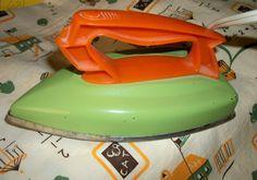 Wolverine vintage toy electric iron, orange and lime green, streamline design