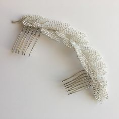 The Lena Hairvine is an elegant and modern bridal accessory, perfect for adding subtle, understated sparkle to the hair. Tiny Seed beads are handwired into individual petals, combining to create a soft vine. Wedding hair inspiration -This piece is very versatile and looks great with either smooth, sleek hairstyles or tousled natural waves