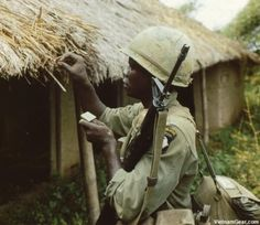 A soldier from the 101st Airborne Division sets a hut containing Viet Cong rice stocks on fire during Operation Van Buren. January, 1966