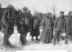 Australians guarding German prisoners captured at Stormy Trench, near Bazentin, in February 1917.
