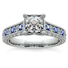 Alternating diamonds and blue sapphires shimmer playfully on this gorgeous Brilliance piece, ready for that proposal moment... The Antique Diamond and Sapphire Gemstone Engagement Ring in Platinum, featuring a Princess-cut diamond center!      http://www.brilliance.com/engagement-rings/antique-diamond-sapphire-gemstone-ring-platinum