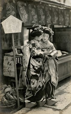 Geisha with O-mikuji, 1910s. O-mikuji are random fortunes written on strips of paper at Shinto shrines and Buddhist temples.
