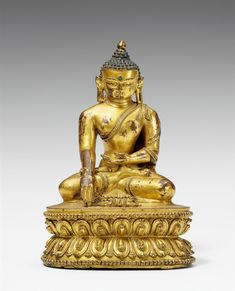 A Tibetan gilt bronze figure of Buddha Shakyamuni with vajra. 15th century  A Tibetan gilt bronze figure of Buddha Shakyamuni, seated in dhyanasana on a double lotus base, with his hands in dhyana and bumisparsa mudra with the vajra placed before him, clad in a diaphanous sanghati with the hems incised with foliage pattern, the urna marked with an inlaid turquoise. Old restoration to the back. Base open. 15th century.  Height 18.5 cm