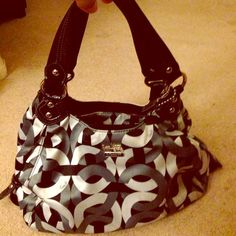 Authentic Coach gray and black gorgeous handbag Used with some stains inside/outside of bag. Handbag has 3 compartments. Very roomy and in great condition. No trades Coach Bags