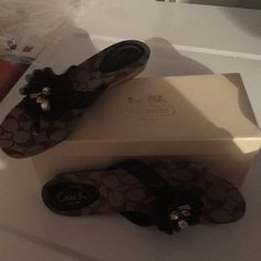 Brown coach sandals Brown coach sandals, thong slide on, small accessories with flower. Almost brand new worn once barely. Sell with the box!! Coach Shoes Sandals