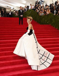 Sarah Jessica Parker wearing Oscar de la Renta this evening at The Metropolitan Museum of Art Costume Institute Benefit. Her gown is ivory duchess satin and black velvet with an exposed crinoline