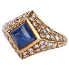 Shine brightly with this French-made vivid Vintage Burma natural sapphire Diamond 18K Gold pave Ring! This ring had 1 scintillating Genuine Natural No heat Suger loaf shapesapphire with Burma origin and AGL lab Report, bezel-set Weighing approx. 1.90 carats Complimenting the sapphire are glittering genuine natural diamonds of total 1.200 carats, F-G color and VS clarity. The diamonds are pave set throughout in the crafted 18k yellow gold, to create a feminine yet bold aesthetic. Remains in excel Pave Ring, Gold Band Ring, Gold Bands, Natural Sapphire, Natural Diamonds, Blue Band, Lab Report, Vintage Diamond, Sapphire Diamond