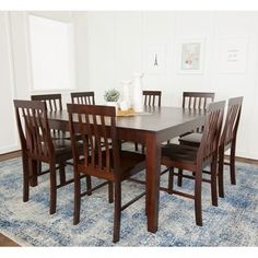 This simple, yet elegant 60-inch wood dining table is the perfect addition to any kitchen or dining room. Crafted from high-grade MDF and featuring solid wood legs with a wood veneer finish, this tabl