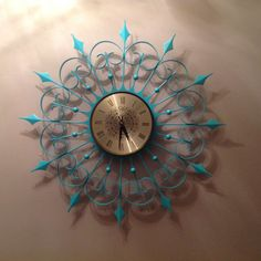 1968 Elgin Spanish style clock. One prong was reattached, rust was sanded off then repainted turquoise.