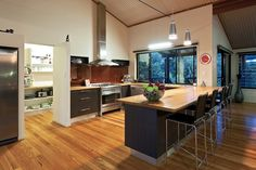 Love the walk in pantry and natural wood breakfast bar