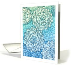 Detailed hand drawn floral mandala zentangle style doodles decorate this blank note card, in shades of navy blue, aqua, turquoise, emerald green, mint and cream. Perfect for any occasion.
