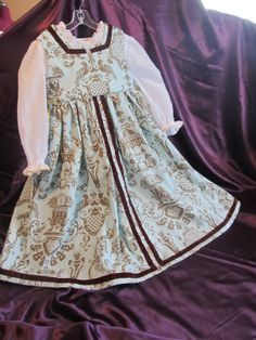 Girl's Renaissance Italian Light Blue and by DashingDamselDesigns, $185.00....This is a one of a kind dress for a little girl, based off of the gowns of the Italian Renaissance. The fabrics are a brocade cotton print and light cotton voile.
