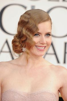 Amy Adams: With a crimped wave and low-slung chignon, best supporting actress nominee Amy Adams had the feminine look down.