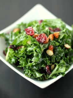 "Raw kale salad with dried cranberries and toasted almond. Note from Gabi: kale is SO GOOD FOR YOU!  If you're not sure you like kale, try this recipe. Call it a ""gateway"" salad. :) You might decide you like it after all!"