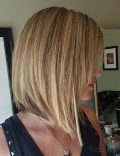 Short angled bob w/ long side swept bangs - Exactly what I want to do.