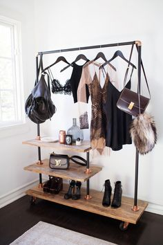 Dress hanging on right side, jacket/shrug top left, accessories on shelves underneath