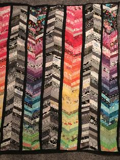 Rainbow scrappy chevron quilt