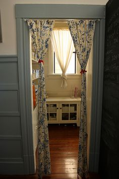 I like the idea of drapes in a doorway