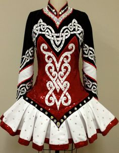 Irish Dance Solo Dress, very feminine,note the drop waist which emphasizes the hips and the knot work emphasizing bodice - this style is far more body conscious than previous styles