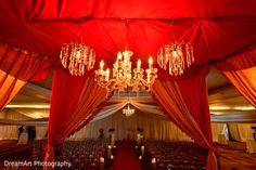 Elegant chandeliers decorating the wedding ceremony venue. http://www.maharaniweddings.com/gallery/photo/83647 @BELoungeOC