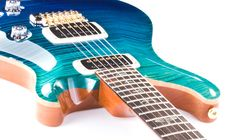 This PRS 408 Artist Package, finished in custom color Blue Fade, features a list of appointments you won't find on any other guitar. $4030. The top is a PRS Artist-Grade flame maple top. The markings in the flame are uniform and well defined with absolutely zero inconsistencies. The fretboard is special as well - Brazilian Rosewood. Despite the perfect tonal characteristics of this wood, it's getting harder and harder to find it on new guitars.  ППц стоит...Оч красивый цвет.