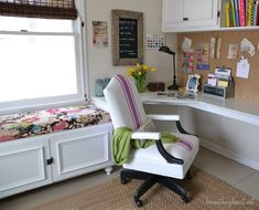 I love the white bench with the patterned fabric. I also want the corner desk!