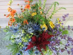 Three sets of complements: Blue & Orange; Red & Blue (with lots of green thrown in for good measure) Blue And Purple Flowers, Purple Yellow, Blue Orange, Red And Blue, Blue Green, Flower Crafts, Design Projects, Wedding Colors, Floral Arrangements